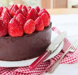 1024x682px Beautiful Triple Layer Chocolate Cake Topped With Strawberries Picture in Chocolate Cake