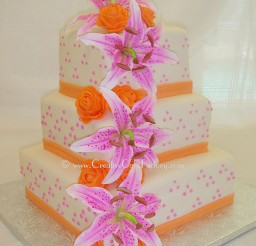 1024x1283px Stargazer Lily Wedding Cake With Orange Ribbon Picture in Wedding Cake