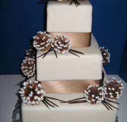 1024x1369px Winter Wonderland Wedding Cake With Chocolate Ribbo Picture in Wedding Cake